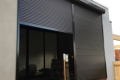 how do roller shutters work?